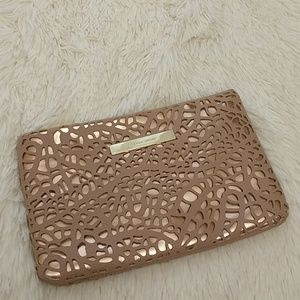 Ivanka Trump laser cut rose gold clutch